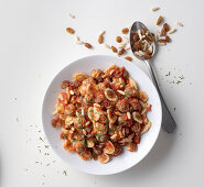 Orecchiette with mini meatballs, tomatoes, raisins and pine nuts