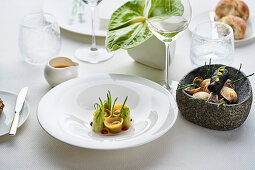 Ravioli with puntarelle and sardines in a black tempura coating