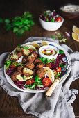 Falafel salad plate with hummus