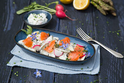 Green asparagus salad with sour cream and marinated salmon trout