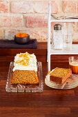 Gluten-free carrot cake with orange and cream cheese frosting