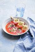 Tomato soup with asparagus ravioli