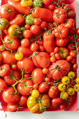 A crate of various types of tomatoes