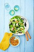 Chicory salad with potato croutons and blackcurrants
