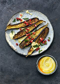 Aubergines with saffron yoghurt and pomegranate seeds