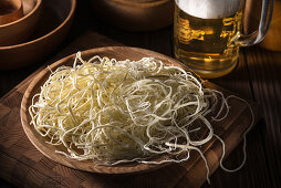 Cheese 'spaghetti' with beer
