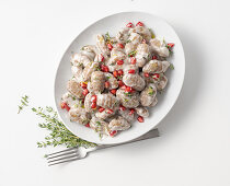 Chestnut gnocchi with Parmesan sauce and pomegranate seeds