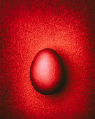 Dark red Easter egg on a dark red background