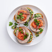 Crostini with boiled beef, green and red salsa and anchovies