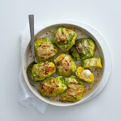 Cabbage roulades with saffron rice and asiago cheese