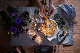 Sauerkraut quiche with apples on a festively laid table for two