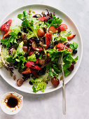 Summer salad with berries, nuts and balsamic vinegar