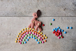 A stuffed animal on a Smarties rainbow