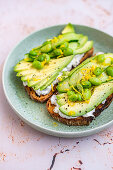 Sliced Avocado on Toast with Labneh, Lemon, Edamame and Cucumber