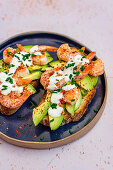 Avocado Slices on Toast with Fried Prawns, Aleppo Pepper and Aioli