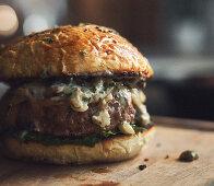A stuffed burger with a creamy mushroom sauce