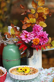 Autumn bouquet with dahlias, marigold, beech twigs and autumn leaves