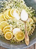 Elderflowers, lemon slices and sugar for preserving