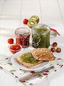 Gooseberry-kiwi jam and strawberry jam