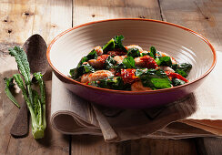 Gnocchi with black cabbage, dried peppers and tomato sauce