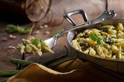 Ligurian trofie with pesto, potatoes, beans and pecorino cheese
