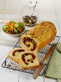Red pesto roll with salami and black olives
