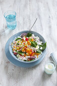 Exotic rice salad with vegetables and pineapple on plate