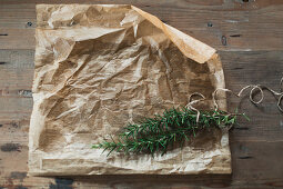 Parchment paper and fresh rosemary