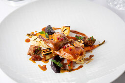 Braised quail with figs and roasted root vegetables