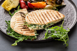 Mediterranean pita bread filled with cheese with grilled vegetables