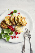 Vegetarian pointed cabbage and apple fritters with hot mustard