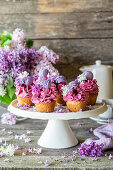 Blueberry cupcakes decorated with mini macarons