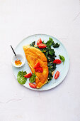 omelet filled with spinach and tomatoes