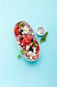 Tomato salad with red onions, black olives and feta cheese