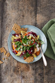 Colourful salad with pumpkin and walnut crackers