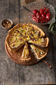 Cheese tart with walnuts, with tomato salad