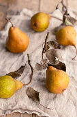 Pears with leaves on a linen napkin
