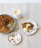 Muesli crumble with vanilla sauce