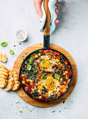 Shakshuka with chickpeas, spinach, and egg