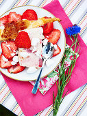 Strawberry parfait with caramelized puff pastry and meringue crumbs