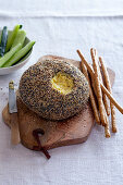 Comte cheese ball with curry and poppy seed