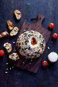 Goat's cheese ball with tomatoes and seeds
