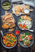 Sandwich with meat, salad with baked turkey, crostini, gnocchi with meat ragu