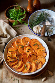 Roasted slices of sweet potato served in a baking form