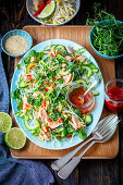 Glass noodle and salmon salad with veggies and herbs