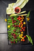 Sweet and sour pea salad with sweet cherries and caramelized tomatoes