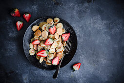 Mini pancake cereal with strawberries