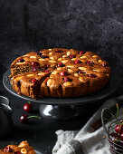 Almond and cherry cake with brandy and honey syrup