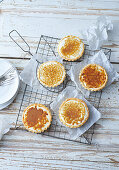 Passion fruit tarts with almond shortcrust pastry