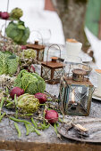 Vintage lanterns, red onions, and cabbage heads as table decorations